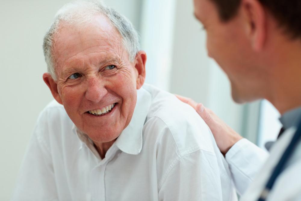 elderly man being reassured by mediator