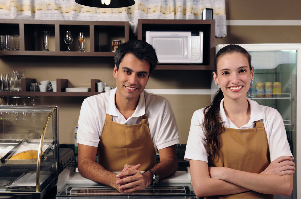 two employees in cafe
